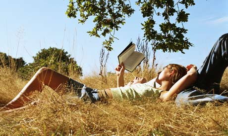 Young-couple-reading-a-bo-001